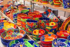 Mallorquin stoneware in colorful designs. MALLORCA, SPAIN - SEPTEMBER 5, 2018: Mallorquin stoneware in colorful designs in the Sineu market on a sunny day on royalty free stock images