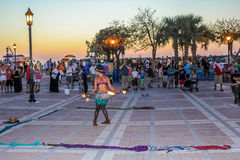 Mallory Square fire eater. Key West, Florida, United States - April 12, 2012: fire eater walking on hot coals during the Sunset Celebration, Mallory Square. Show Stock Photo