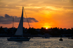 Mallory square sunset. Few boats on water during sunset Stock Photography