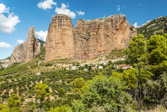 Mallos de Riglos with fields. View of the Mallos de Riglos, is a cloudy day. It is located in the Spanish province of Huesca along the Pyrenees. You can see some Royalty Free Stock Photos