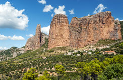 Mallos de Riglos with fields. View of the Mallos de Riglos, is a cloudy day. It is located in the Spanish province of Huesca along the Pyrenees. You can see some Royalty Free Stock Images