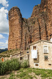 Mallos de Riglos with house. View of the Mallos de Riglos, is a cloudy day. It is located in the Spanish province of Huesca along the Pyrenees. You can see a Stock Images
