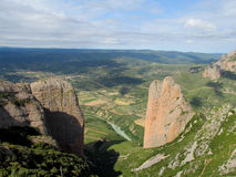 Mallos de Riglos rock canyon, Spain. Mallos de Riglosset ofconglomeraterock formationsAragon,Spain. spectacular view on a sunny day. Unusual shaped red Stock Images