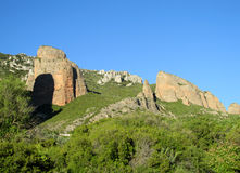 Mallos de Riglos rocks, Spain. Mallos de Riglosset ofconglomeraterock formationsAragon,Spain. spectacular view on a sunny day. Unusual shaped red rock Stock Photography
