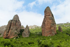 Mallos de Riglos rocks, Spain. Mallos de Riglos set of conglomerate rock formations Aragon, Spain. spectacular view on a sunny day. Unusual shaped red rock Stock Photo