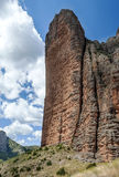 Mallos de Riglos. View of the Mallos de Riglos vertically, is a cloudy day. It is located in the Spanish province of Huesca along the Pyrenees Royalty Free Stock Photo