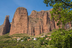 Mallos de Riglos village and rock mountain. The Mallos de Riglos are a set of conglomerate rock formations in Hoya de Huesca comarca, Aragon, Spain Royalty Free Stock Photo