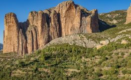 Mallos of Riglos in Huesca, long shot panorama. Long shot panorama of Mallos of Riglos against blue sky, Huesca Spain Royalty Free Stock Photos