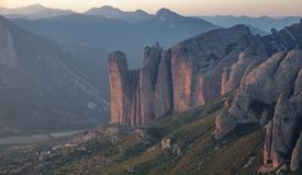 Mallos of Riglos in Huesca, long shot from top of the mountain. Long shot of Mallos of Riglos after sunset Stock Photo