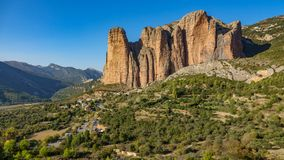 Mallos of Riglos in Huesca, long shot. Long shot view of Mallos of Riglos against blue sky, Huesca Spain Stock Photo