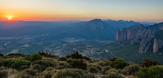 Mallos of Riglos at sunset from top of the mountain. Wide panorama of Mallos of Riglos at sunset from top of viewpoint Royalty Free Stock Image