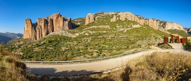Mallos of Riglos wide panorama in Huesca. Wide panoramic view of Mallos of Riglos and bird center against blue sky, Huesca Spain Stock Photography