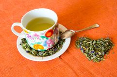 Mallow herbal tea cup. On orange background Royalty Free Stock Photography