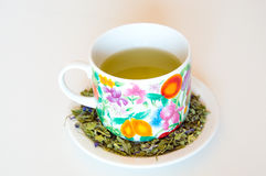 Mallow herbal tea cup. On orange background Royalty Free Stock Images