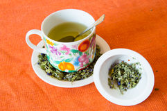 Mallow herbal tea cup. On orange background Stock Photography