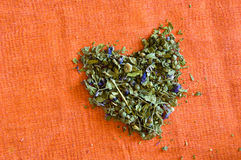 Mallow herbal tea love. Mallow herbal tea on orange background love and heart Royalty Free Stock Photography