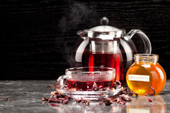 Mallow tea in glass. Cup with honey Royalty Free Stock Image
