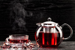 Mallow tea in glass. With dried mallow blossoms Stock Photos