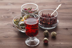 Mallow tea in glass with dried mallow blossoms Stock Image