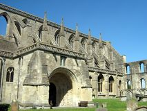 Malmesbury Abbey entrance & graveyard in Wiltshire, England, Europe. A religious house dedicated to Saint Peter and Saint Paul in the 7th century Stock Image
