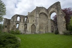 Malmesbury Abbey Transept Remains. Malmesbury Abbey is a fragment of the original building much of which collapsed in the 18th Century. This view shows the Royalty Free Stock Photography