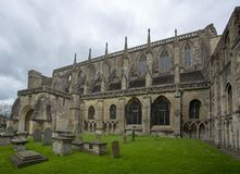 Malmesbury Abbey parish church. Malmesbury Abbey is a fragment of the original building much of which collapsed in the 18th Century.  The abbey is now used as a Royalty Free Stock Image