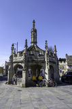 Malmesbury Market Cross. Cyclists rest under Malmesbury's medieval Market Cross Stock Images