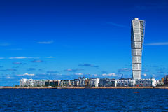 Malmo Cityscape with Turning Torso. MALMO, SWEDEN - JUNE 26, 2015: Malmo Cityscape with Turning Torso as Distinctive Landmark of this Swedish Town. Malmo is the Stock Image