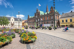 Malmo on a sunny summer day in Sweden. Malmo, Sweden – July 2, 2014: The big square and the old city hall in Malmo on a sunny summer day. The square in Sweden Stock Photography
