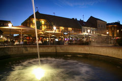 MALMO, SWEDEN - AUGUST 16, 2016: View of beautiful night scene a. Nd fountain on the market place Lilla Torg in Malmo, Sweden on August 16, 2016 Stock Photography