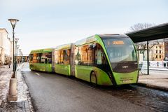 Modern double articulated bus Van Hool 324H Exequicity 24 Hybrid. MALMO, SWEDEN - 29 DEC 2014: Modern double articulated bus Van Hool 324H Exequicity 24 Hybrid royalty free stock photography