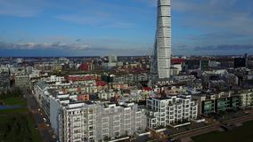 Aerial View of Turning Torso Skyscraper in Sweden. Malmo, Sweden - July 28, 2017: Aerial view of the west harbor area with the Turning Torso skyscraper stock footage
