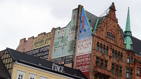MALMO, SWEDEN - MAY 31, 2017: Palaces that overlook the square Stortorget with some vintage advertisings, Malmo, Sweden Royalty Free Stock Photo