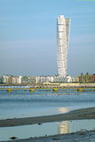 Malmo Turning Torso and cityscape. MALMO, SWEDEN - DECEMBER 21, 2015: Malmo Turning Torso, distinctive Swedish city landmark is designed by Spanish architect Stock Images