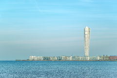 Malmo Turning Torso and cityscape. MALMO, SWEDEN - DECEMBER 21, 2015: Malmo Turning Torso, in Oresund West Harbor Area, Tallest Building in Sweden and Stock Photography