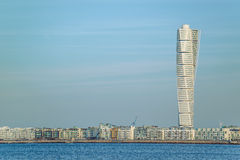 Malmo Turning Torso and cityscape. MALMO, SWEDEN - DECEMBER 21, 2015: Malmo West Harbor area cityscape with Turning Torso as landmark of this Swedish town, Malmo Stock Photography