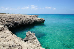 Malmok Beach - Aruba. Malmok Beach formations in Aruba and its incredible blue color sea Stock Image