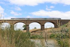 MALMSBURY, AUSTRALIA - February 11, 2018: A Bendigo to Melbourne. V/Line train travelling over the Coliban River on the Malmsbury viaduct stock photos