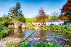 Malmsmead Bridge. The bridge and ford at the picturesque hamlet of Malmsmead in the Doone Valley directly on the border between Somerset and Devon Stock Image