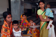 Malnourished Children in India. May 03, 2011-ThakurPukur,Kolkata, West Bengal,India -Poor mother & child in the clinic center of Kolkata Royalty Free Stock Photo