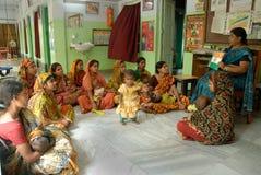 Malnourished Children in India. May 03, 2011-ThakurPukur,Kolkata, West Bengal,India -Poor mother & child in the clinic center of Kolkata Stock Photo