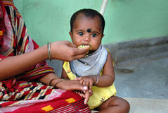 Malnourished Children in India. May 03, 2011-ThakurPukur,Kolkata, West Bengal,India -Poor mother giving food to her child in the clinic center of Kolkata Royalty Free Stock Photos