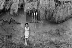 Malnourished Children in India. July 18,2011 Chunakhali,West Bengal,India,Asia-A poor girl standing behind a broken wall of the house Stock Photography