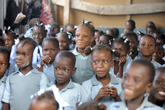 Malnourished in School. Children in a Haitian Desert School,  The light hair of the standing girl in the middle is a sign of significant malnutritian.  Shallow Royalty Free Stock Photography