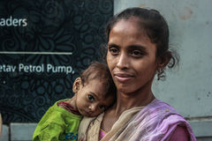 Malnutrition/slum India. Photo of child sufferring from Malnutrition with his mother. India is one the countery where malnutrition cases are registered in large Stock Photo