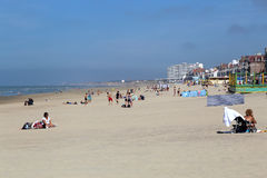Malo les Bains beach in Dunkirk, France. Dunkirk, France - May 31, 2017: Tourists on the sunny beach at the Malo les Bains beach resort of Dunkirk, France on May Royalty Free Stock Photo