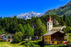 Maloja under blue sky in summer. Picturesque village of Maloya near St. Moritz under a clear blue sky in summer Engadin, Grisons, Switzerland Stock Photos