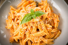 Maloreddus with ragout and cheese. Dish of sardinian pasta with ragout sauce and grated cheese, Italian Food Stock Photo