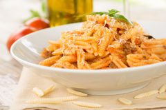 Maloreddus with ragout and cheese. Dish of sardinian pasta with ragout sauce and grated cheese, Italian Food Royalty Free Stock Photo