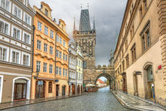 Malostranska tower and old buildings in Prague. Malostranska tower and old buildings on Mostecka street in Pargue, Czech Republic Royalty Free Stock Images